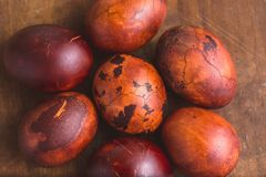 Easter eggs on wooden background. Painted brown with spots and cracks. Selective focus macro shot with shallow DOF.  stock photos