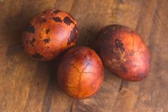 Easter eggs on wooden background. Painted brown with spots and cracks. Selective focus macro shot with shallow DOF.  stock images