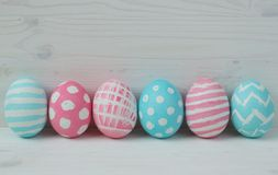 Easter eggs on a wooden background Stock Images