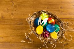 Easter eggs on wooden background, top view royalty free stock photos
