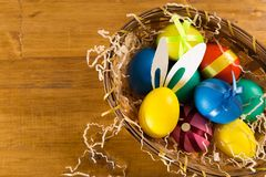 Easter eggs on wooden background, top view stock photos