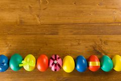 Easter eggs on wooden background, top view royalty free stock photography