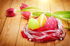 Easter eggs on wooden background with tulips Royalty Free Stock Photography