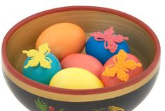 Easter eggs in wooden basin Royalty Free Stock Images