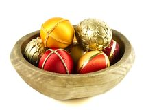 Easter eggs in a wooden bowl Stock Photos