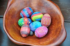 Easter eggs in a wooden bowl stock image