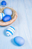 Easter eggs in wooden bowl Royalty Free Stock Image
