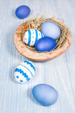 Easter eggs in wooden bowl Royalty Free Stock Photo