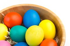Easter eggs in wooden bowl royalty free stock photography