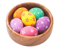 Easter eggs in wooden bowl Royalty Free Stock Images