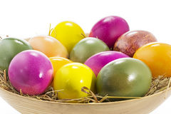 Easter eggs in a wooden bowl, large DOF Royalty Free Stock Photos