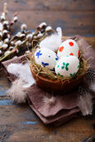 Easter eggs in a wooden bowl Royalty Free Stock Images