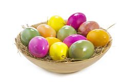 Easter eggs in a wooden bowl Royalty Free Stock Image