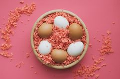 Easter eggs in a wooden bowl. stock image