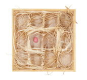 Easter eggs in a wooden box Royalty Free Stock Photos