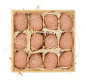 Easter eggs in a wooden box Stock Images