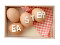 Easter eggs in wooden box isolate (clipping path). Stock Images