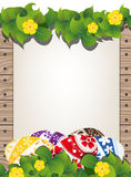 Easter eggs on the wooden fence background Stock Images