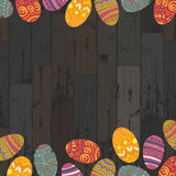 Easter eggs on wooden planks background. Royalty Free Stock Photos