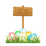 Easter eggs and wooden sign Stock Photo