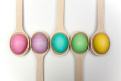 Easter eggs in wooden spoons  on white Royalty Free Stock Images