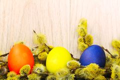 Easter eggs on a wooden surface Royalty Free Stock Photo