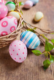 Easter eggs on a wooden surface Stock Photo