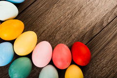 Easter eggs on wooden table background Royalty Free Stock Image