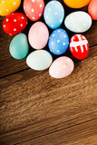 Easter eggs on wooden table background Royalty Free Stock Photos