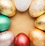 Easter eggs on wooden table with blank paper for text. Stock Images