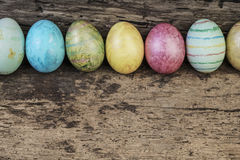 Easter eggs on wooden table Royalty Free Stock Photos