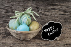 Easter eggs on wooden table Stock Images