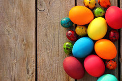 Easter eggs on wooden table. Colorful easter eggs on wood table close up