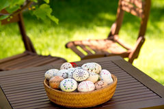 Easter Eggs. On The Wooden Table In The Garden stock photo