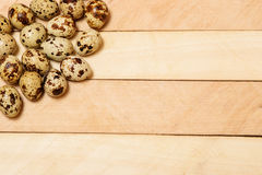 Easter eggs on wooden texture Stock Photo
