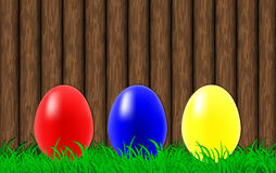 Easter eggs on a wooden wall background Stock Images