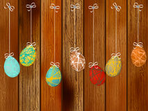 Easter eggs on a wooden wall. + EPS8. Easter eggs on a wooden background. + EPS8 vector file Vector Illustration
