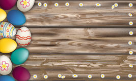 Easter Eggs Worn Wood Daisy Flowers. Easter eggs with daisy flowers on the wooden background Royalty Free Stock Photos