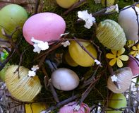 Easter eggs woven into a wreath royalty free stock images