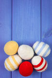 Easter eggs wrapped woolen string on blue wooden boards, copy space for text, decoration for Easter Stock Images