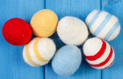 Easter eggs wrapped woolen string on blue wooden boards, decoration for Easter Stock Images