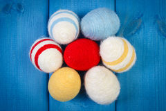 Easter eggs wrapped woolen string on blue wooden boards, decoration for Easter Stock Photos