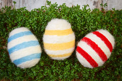 Easter eggs wrapped woolen string and green cress, decoration for Easter Stock Images