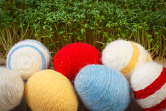 Easter eggs wrapped woolen string and green cress, decoration for Easter Stock Photography