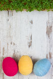 Easter eggs wrapped woolen string and green cress on wooden background, copy space for text, decoration for Easter Stock Image