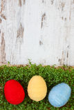 Easter eggs wrapped woolen string and green cress on wooden background, copy space for text, decoration for Easter Stock Photo