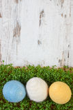 Easter eggs wrapped woolen string and green cress on wooden background, copy space for text, decoration for Easter Stock Photography
