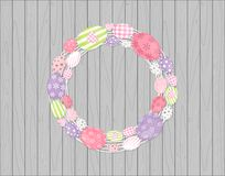 Easter eggs wreath hanging on Wooden rustic background Royalty Free Stock Images