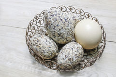 Easter eggs in wrought basket royalty free stock photo