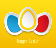 Easter eggs on yellow background. Stock Photos